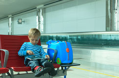 Little boy with touch pad waiting in the airport Stock Image