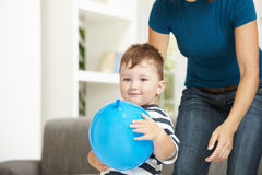 Little boy with toy ballon Stock Photos