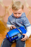 Little boy with toy car Stock Images