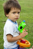 Little boy with a toy gun Royalty Free Stock Image
