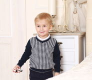 Little boy with toy in hand Royalty Free Stock Image