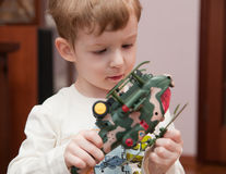 Little boy with toy helicopter Stock Image