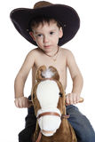 Little boy on a toy horse.child on a white Stock Images