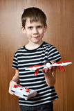 Little boy with toy quadcopter drone Royalty Free Stock Photography