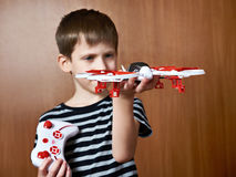 Little boy with toy quadcopter drone Royalty Free Stock Photos