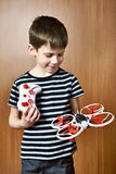 Little boy with toy quadcopter drone Royalty Free Stock Image
