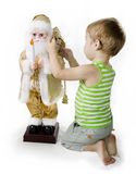 Little Boy and toy Santa Claus Royalty Free Stock Image