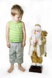 Little Boy and toy Santa Claus Stock Photos