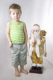 Little Boy and toy Santa Claus Royalty Free Stock Images