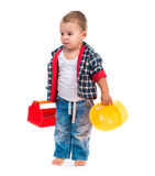 Little boy with toy tools and helmet Royalty Free Stock Image