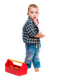 Little boy with toy tools and helmet Royalty Free Stock Images
