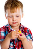 Little boy with a toy Stock Images