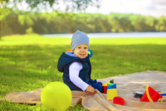 Little boy with toys at picnic Royalty Free Stock Image