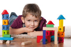 Little boy with toys Royalty Free Stock Image