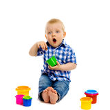 Little boy with toys on a white background Stock Images
