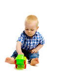 Little boy with toys on a white background Royalty Free Stock Photos