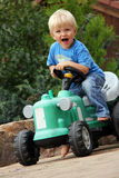 Little boy with tractor. Nice little blonde boy with green tractor toy Royalty Free Stock Photos