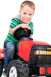 Little boy with tractor Stock Images
