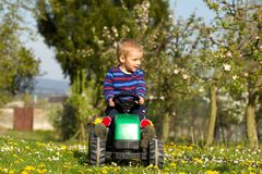Little boy  and tractor. Royalty Free Stock Photo