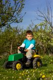 Little boy  and tractor. Royalty Free Stock Images