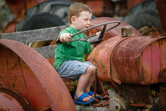 Little boy on a tractor Stock Photography