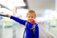 Little boy travel in the airport or train station Royalty Free Stock Photo