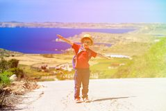 Little boy travel with backpack on scenic road Royalty Free Stock Photography