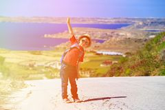 Little boy travel with backpack on scenic road Royalty Free Stock Photos