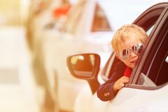 Little boy travel by car in the city Stock Images