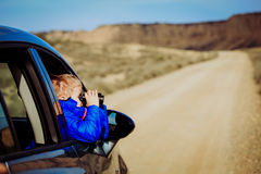 Little boy travel by car on road to mountains Stock Photo