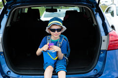 Little boy travel by car in summer Royalty Free Stock Photography