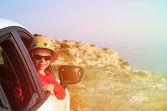 Little boy travel by car in summer mountains Stock Photo