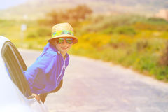 Little boy travel by car in summer mountains Royalty Free Stock Images
