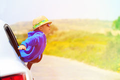 Little boy travel by car in summer mountains Stock Images