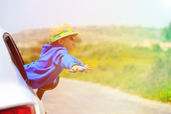 Little boy travel by car in summer mountains Stock Image