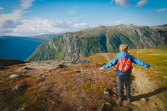 Little boy travel hiking in mountains, family in nature. Travel stock photo