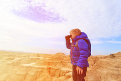 Little boy travel looking at binoculars in Bardenas Reales nationa park Stock Images