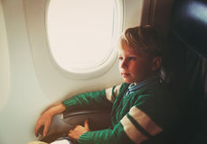 Little boy travel by plane Royalty Free Stock Image