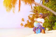 Little boy travel on summer tropical beach Stock Photo