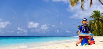 Little boy travel on summer tropical beach with Stock Images