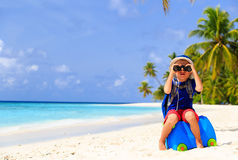 Little boy travel on summer tropical beach Stock Photos