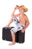 Little boy traveler in hat sits on suitcase Royalty Free Stock Photos