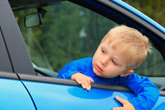 Little boy traveling by car Stock Image