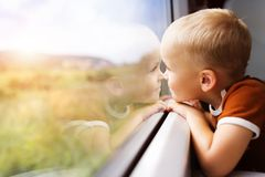 Little boy travelling in train Royalty Free Stock Images