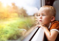 Little boy travelling in train Royalty Free Stock Image