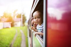 Little boy travelling in train Stock Images