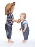 Little boy treated friend apple Stock Photo
