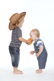 Little boy treated friend apple Royalty Free Stock Images
