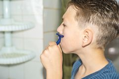 A little boy tries to shave and does not know how royalty free stock images