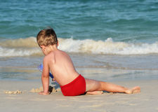 Little boy on a tropical beach royalty free stock image